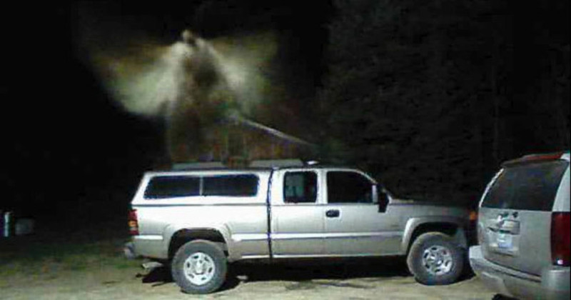 Man Claims Security Camera Captured Angel Floating Above His Truck