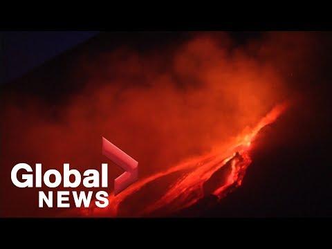 Peeps take selfies while Mount Etna illuminates night sky with lava
